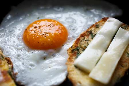 attested: fried egg and bread with cheese, close-up Stock Photo