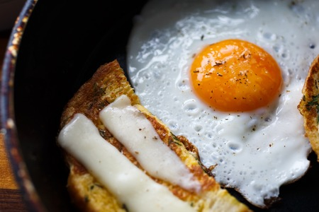 cooked pepper ball: fried egg and bread with cheese, close-up Stock Photo