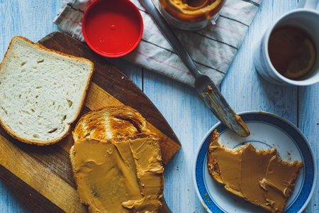 peanut butter and jelly: Peanut butter sandwiches or toasts  on light wooden background Stock Photo