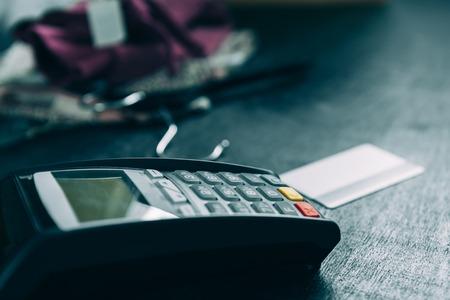 Credit card terminal on the desk in store Foto de archivo