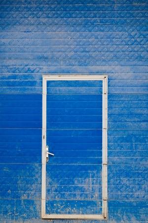shutter door: Blue shutter door and steel door outside factory