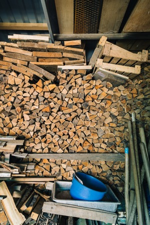 chock: View of a lot of firewood indoor