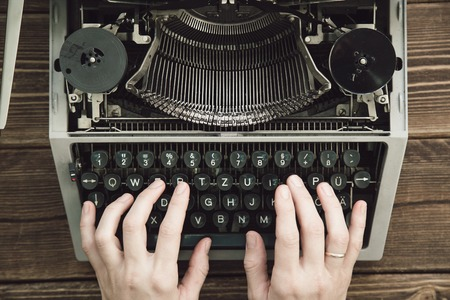 qwerty: Writer typing with retro writing machine. View from above. Stock Photo