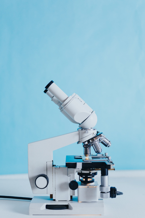 Powerful scientific laboratory microscope with multiple lenses.