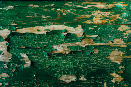 old wooden wall with green cracked paint background