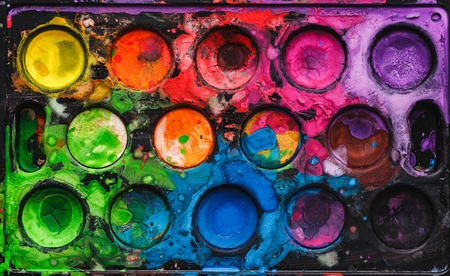 Black watercolor palette with mixed bright colors Stock Photo