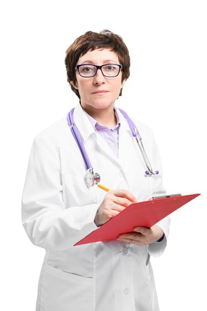 Adult experienced woman doctor with stethoscope write something at clipboard. Isolated on white background. Stok Fotoğraf
