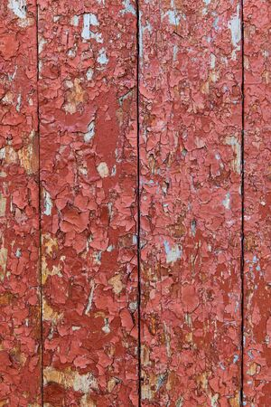 Wooden surface with cracked red paint texture Stock Photo