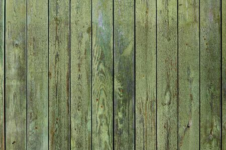 Wooden surface with cracked green paint texture 写真素材