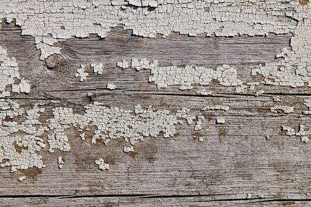 Wooden surface with cracked paint texture