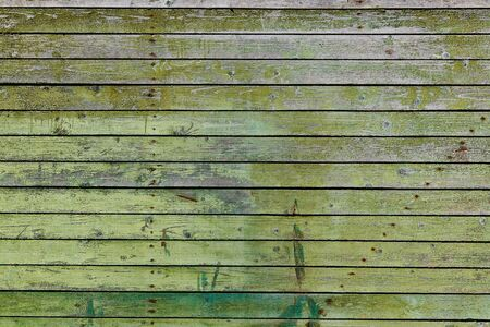 Wooden surface with cracked green paint texture Stock Photo