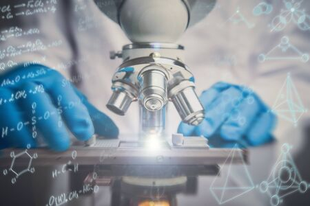 Close-up shot of microscope with metal lens. Chemical formulas effects Stock Photo