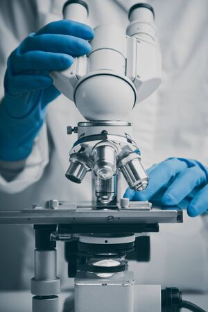 Close-up shot of microscope with metal lens.