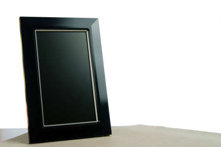black photoframe on the table in white background