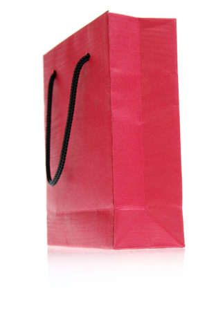 red paper bag shopper isolated on white photo