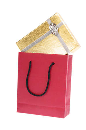gold gift box with bow and red paper bag shopper isolated on white  photo