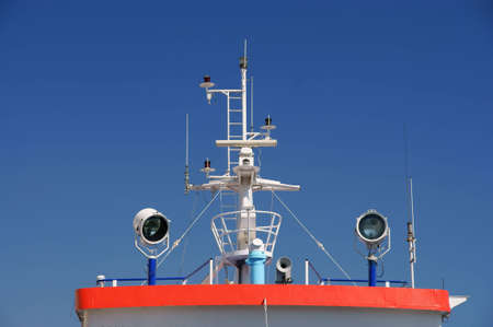 Radar, aerials and telecommunications command center on board of a ship  Stock Photo