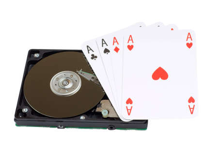 Four Aces and magnetic computer hard disk, mass memory on white background