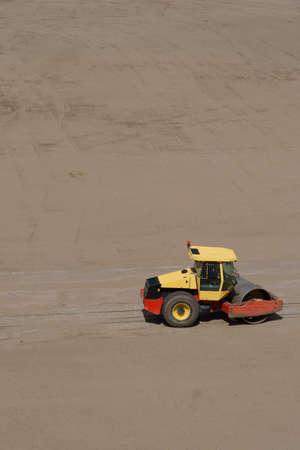 steamroller: Yellow roadroller, steamroller on yard soil