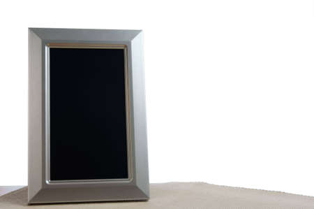 silver photoframe on the table in white background Stock Photo