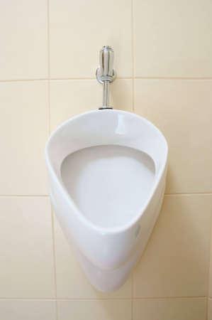 white urinal, pissoir on wall