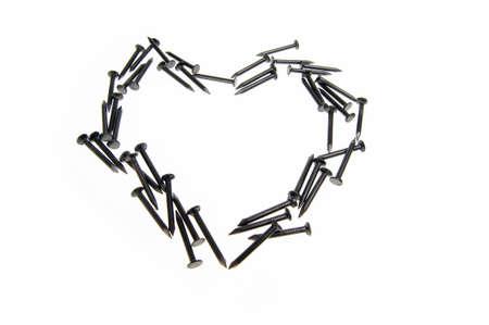 Heart Macro of nails isolated on white background photo