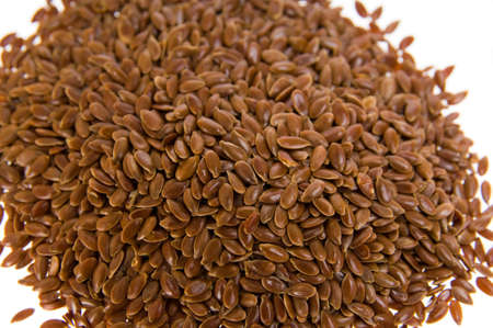 flaxseed: Close up of a pile of flaxseed isolated on white  Stock Photo