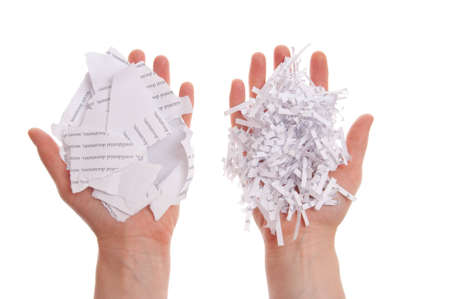 Shredded paper, security white pile in hand  Stock Photo