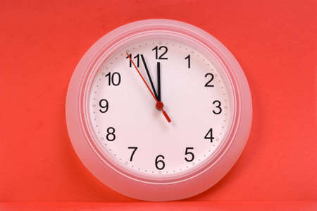 wall clock showing time about twelve photo
