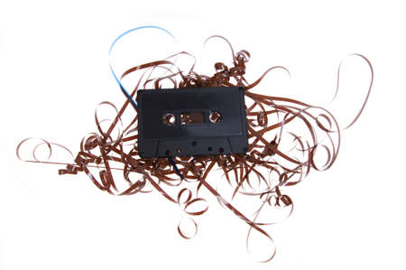 Isolated old broken compact cassette  - music tape
