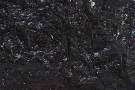 Black reflective coal textured background  Stock Photo