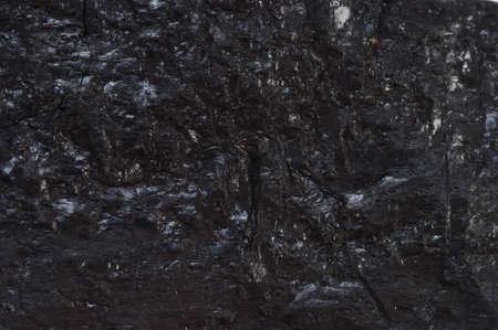 Black reflective coal textured background  Stock Photo