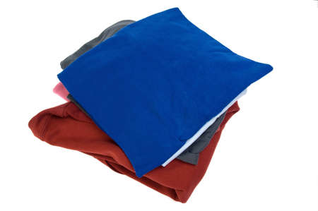 Stack of shirts in different colors isolated on white Stock Photo - 7859204
