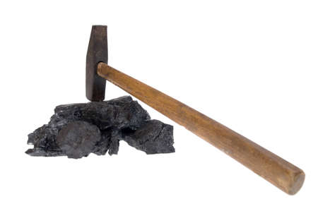 bituminous coal: hammer and coal, carbon nugget isolated on white background