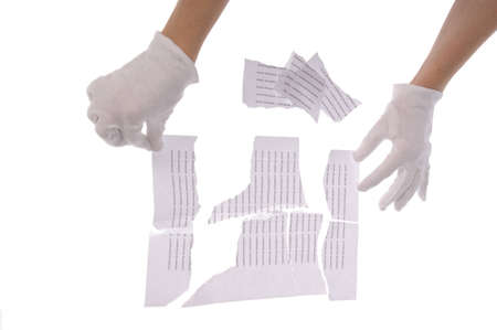 Shredded paper, security white pile in hand  photo