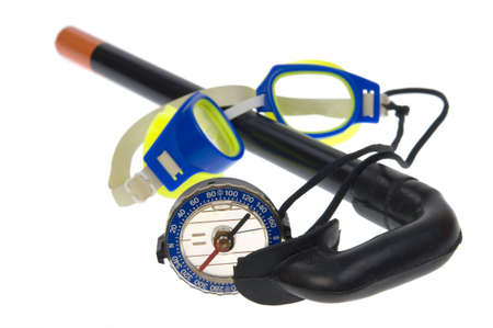 Tourist compass, swimming goggles,  snorkel isolated on a white background photo