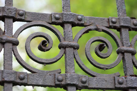 perpendicular: steel picket fence on green background