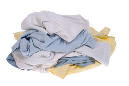 Pile of dirty clothes for the laundry - isolated on white