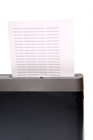 Paper shredder secure document. confidential documents into a paper shredder  photo