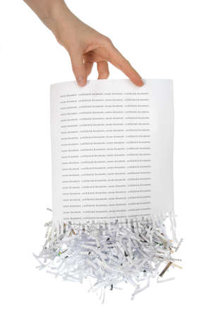 shredder: Shredded paper, security white pile in hand  Stock Photo