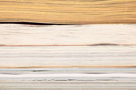stack of opened magazines background texture photo