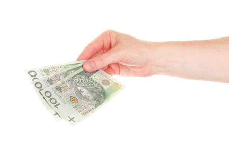 handing over: Polish money isolated on white in hand