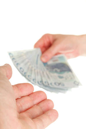 passing over: Polish money isolated on white in hand