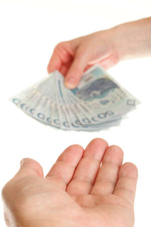Polish money isolated on white in hand Stock Photo - 11101322