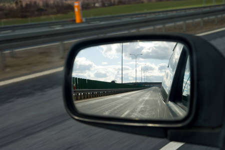 Landscape in the mirror of a car  photo