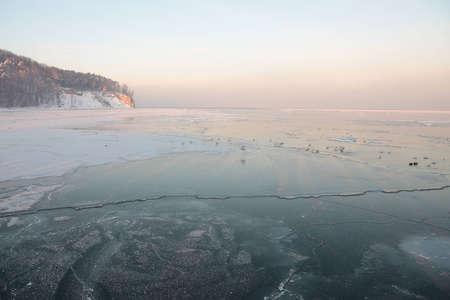 yellow Sunset on the sea - ice - floe. Poland, Gdynia photo