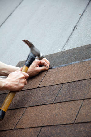 roofer: roofer made a roof with slates hammer in hand