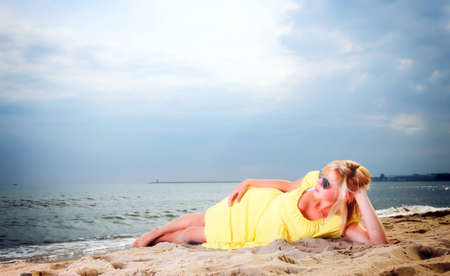 woman reading a book girl the yellow dress water beach photo