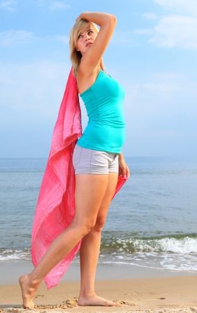 dancing happy girl on the beach woman vacation, summertime fun concept photo