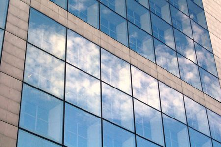 Business building reflecting blue sky Stock Photo - 1352871